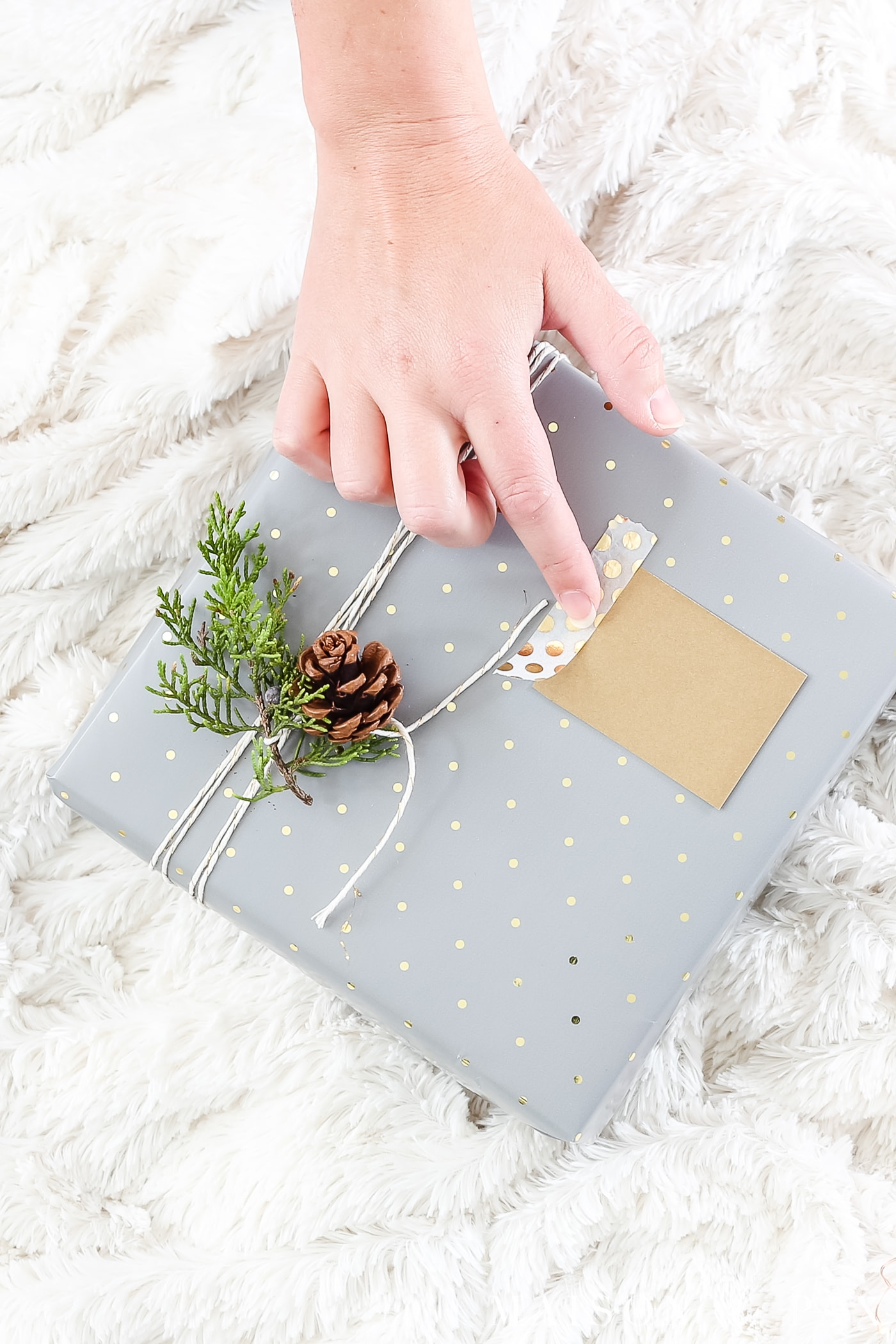 easy gift wrapping ideas: secure gift tags with a quick strip of washi tape #christmaspresents #giftwrap