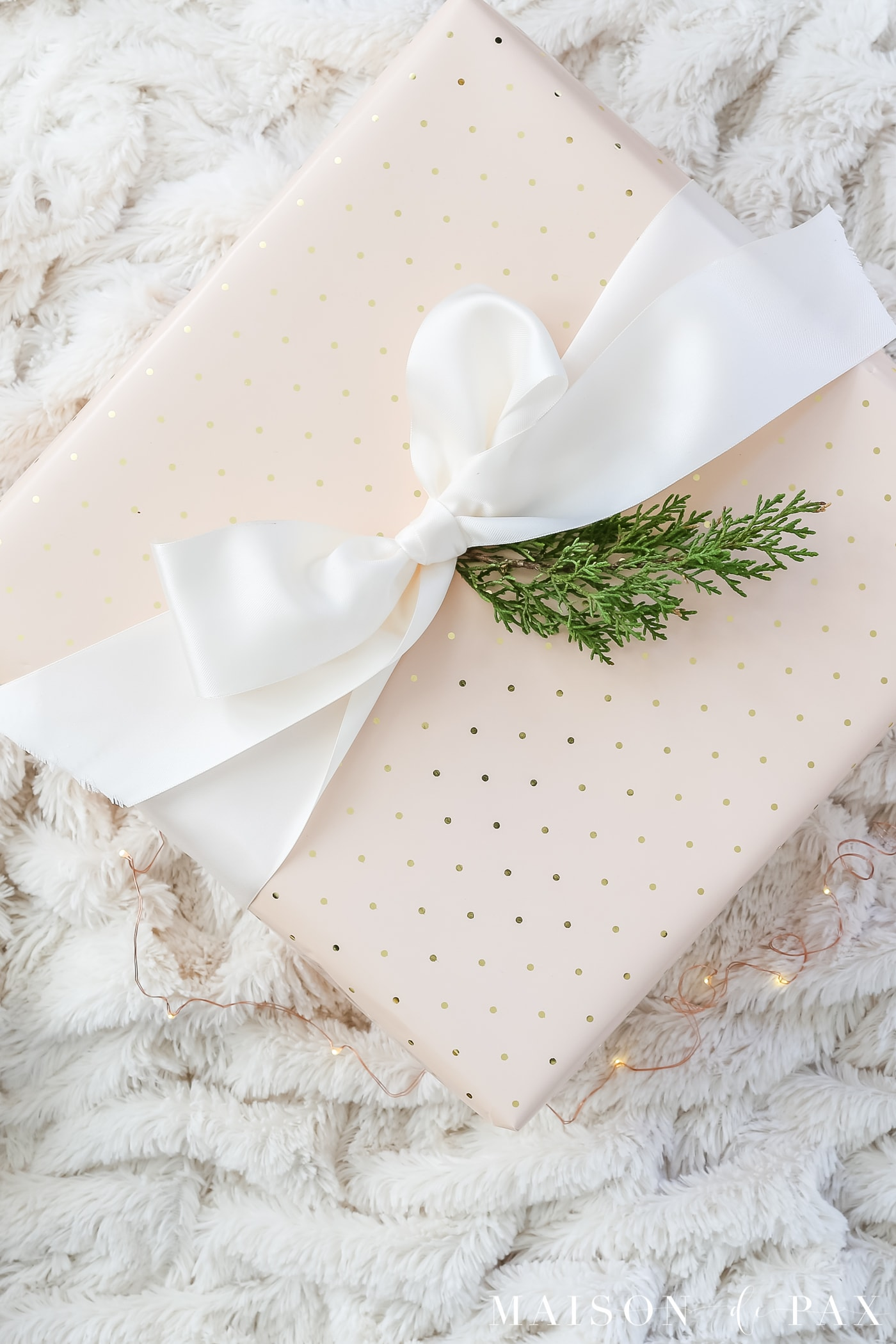easy gift wrapping ideas: a giant satin ribbon makes a big statement #christmaspresents #giftwrap