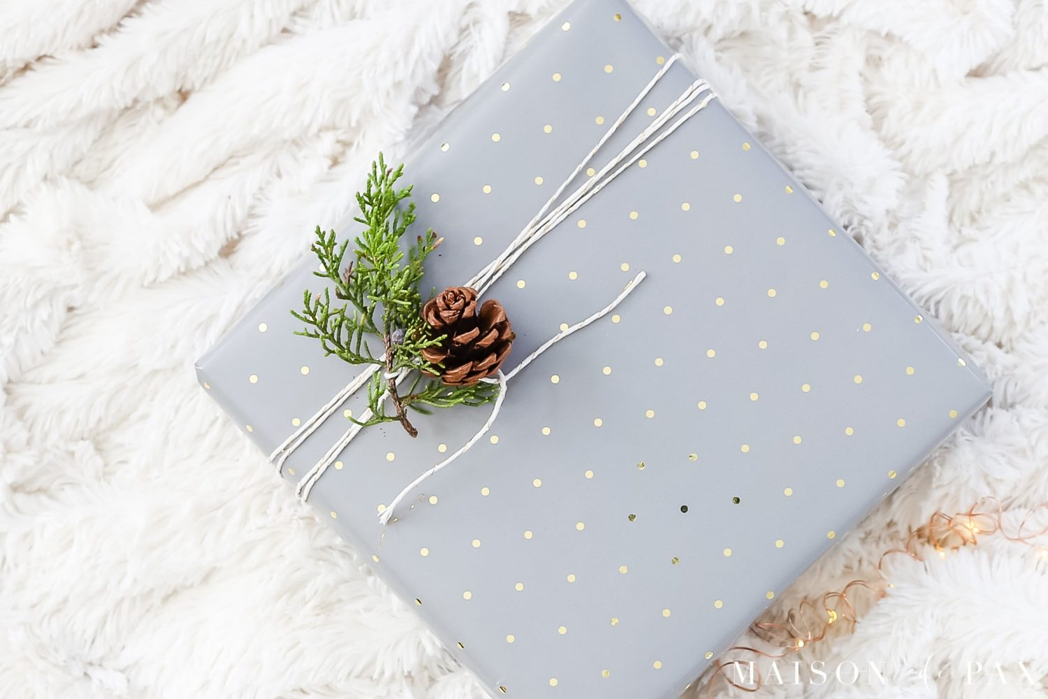 easy gift wrapping ideas: add sprigs of greenery and pinecones to your gifts #christmaspresents #giftwrap