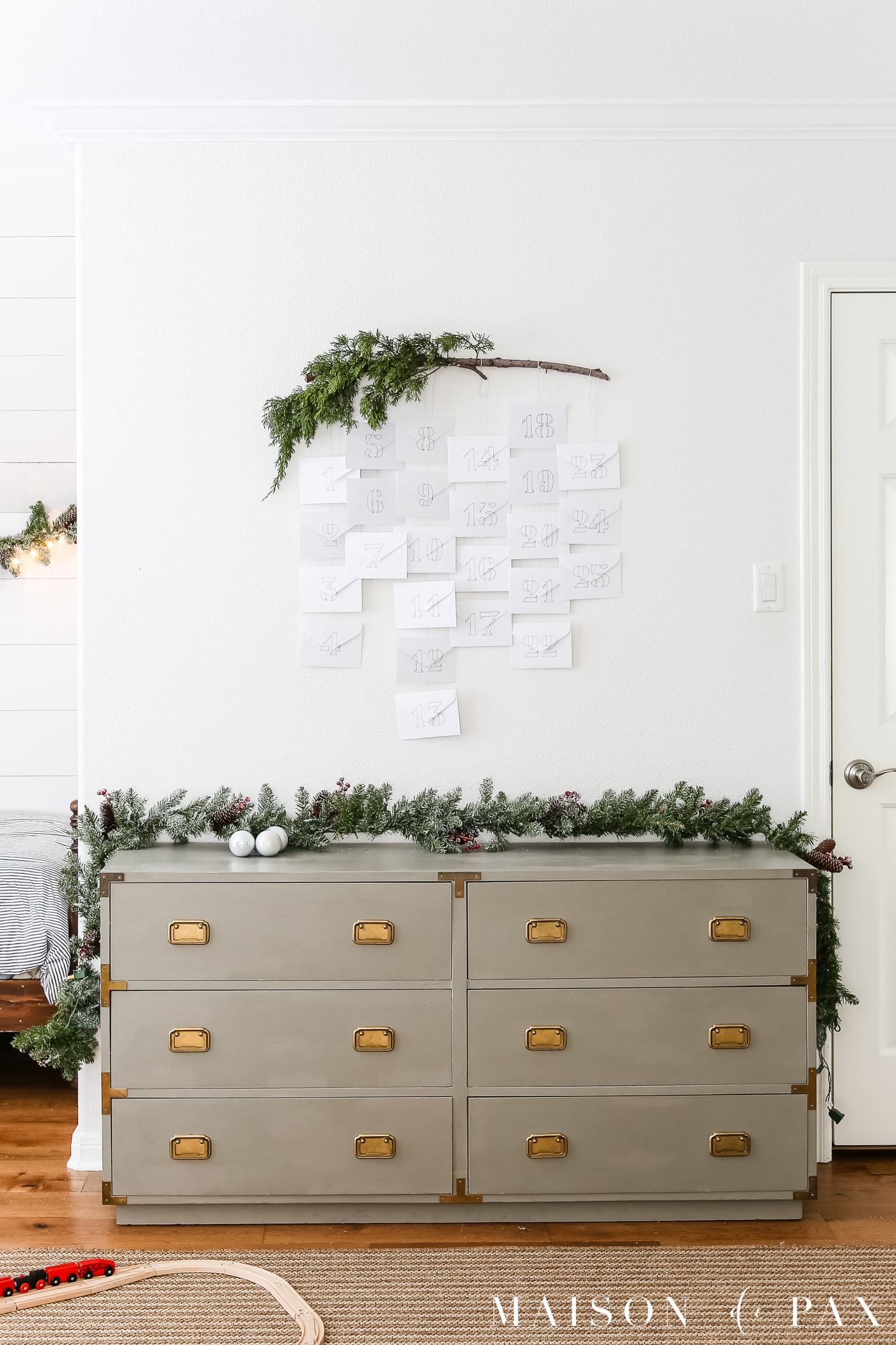 evergreen branch and simple white envelopes make an adorable diy advent calendar #adventcalendar