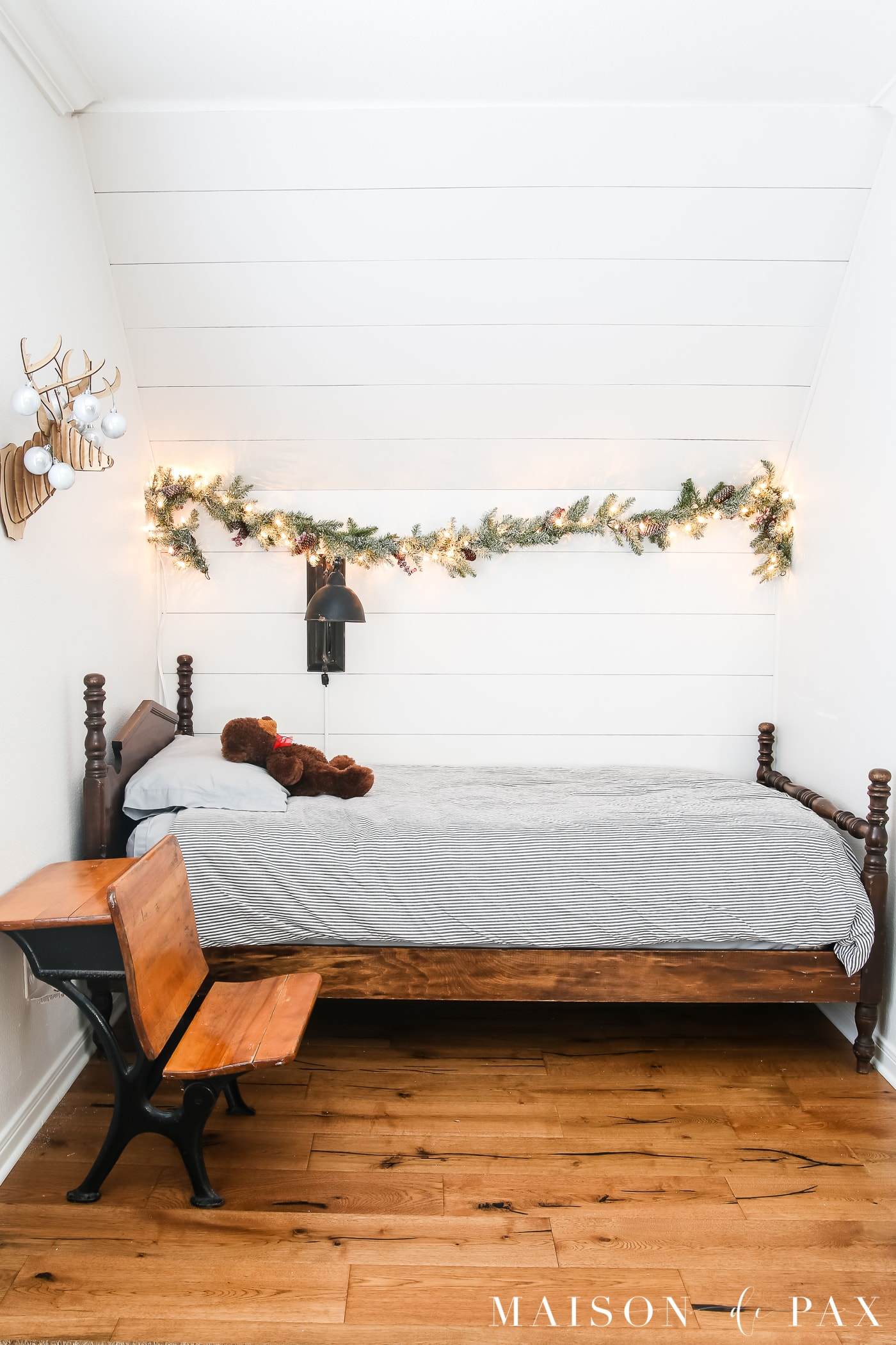 simple lighted garland above a little boy's bed for Christmas #simpleChristmas