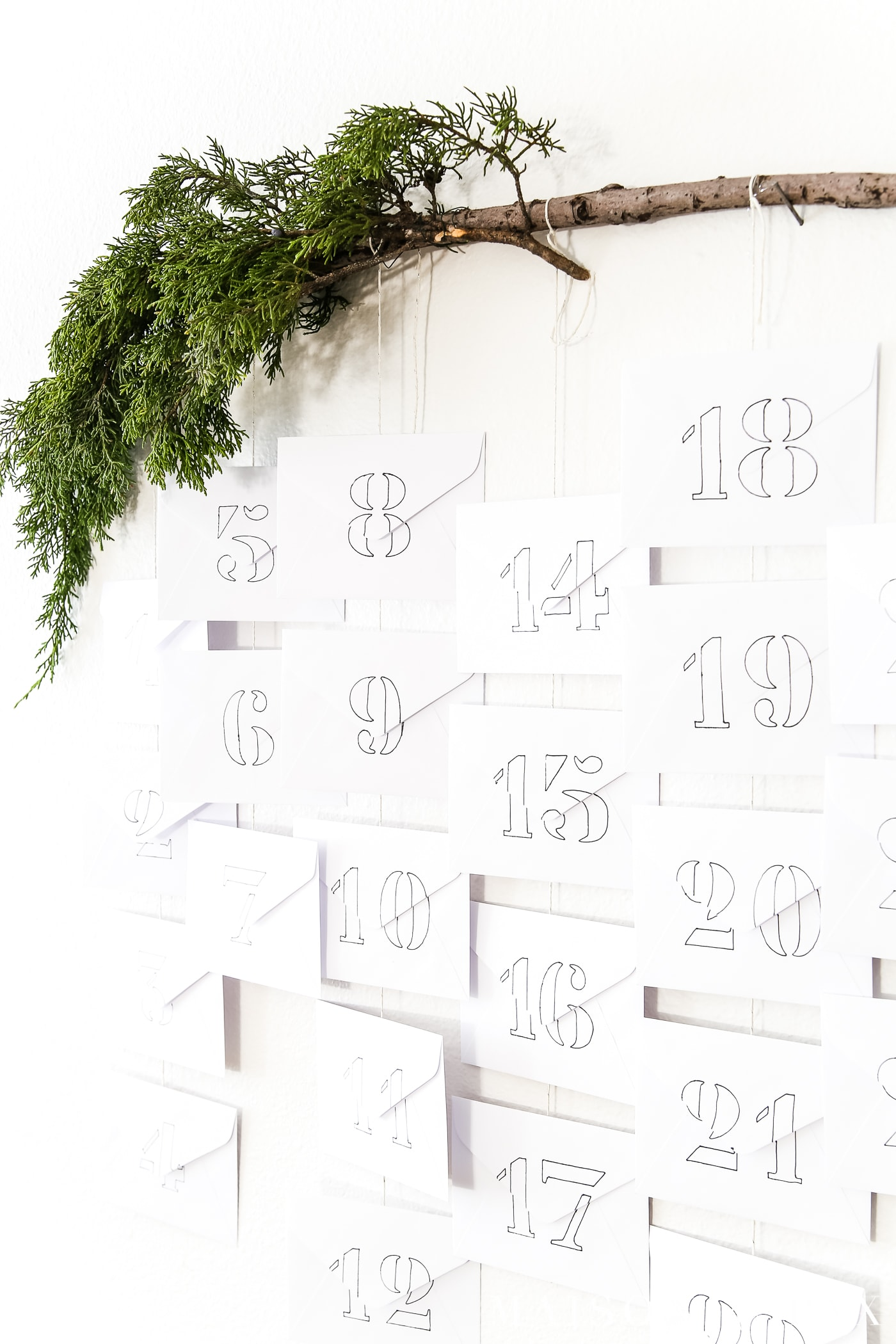 stencil numbers onto basic white envelopes for a diy advent calendar #adventcalendar