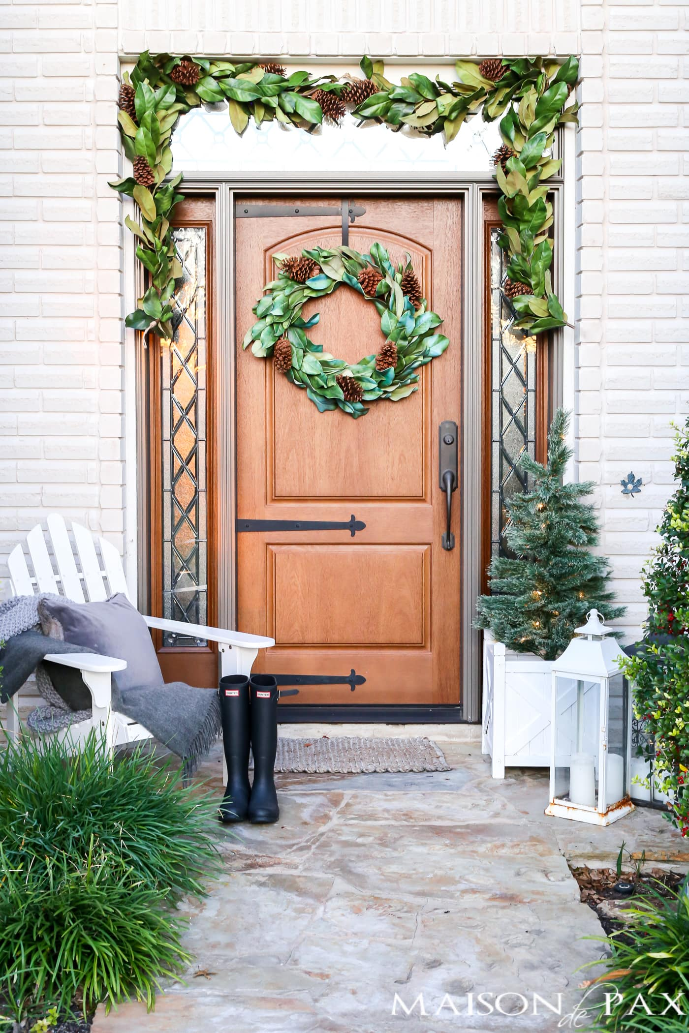 Christmas front porch decorating ideas: magnolia wreath and garland, gray and white accents #christmasporch