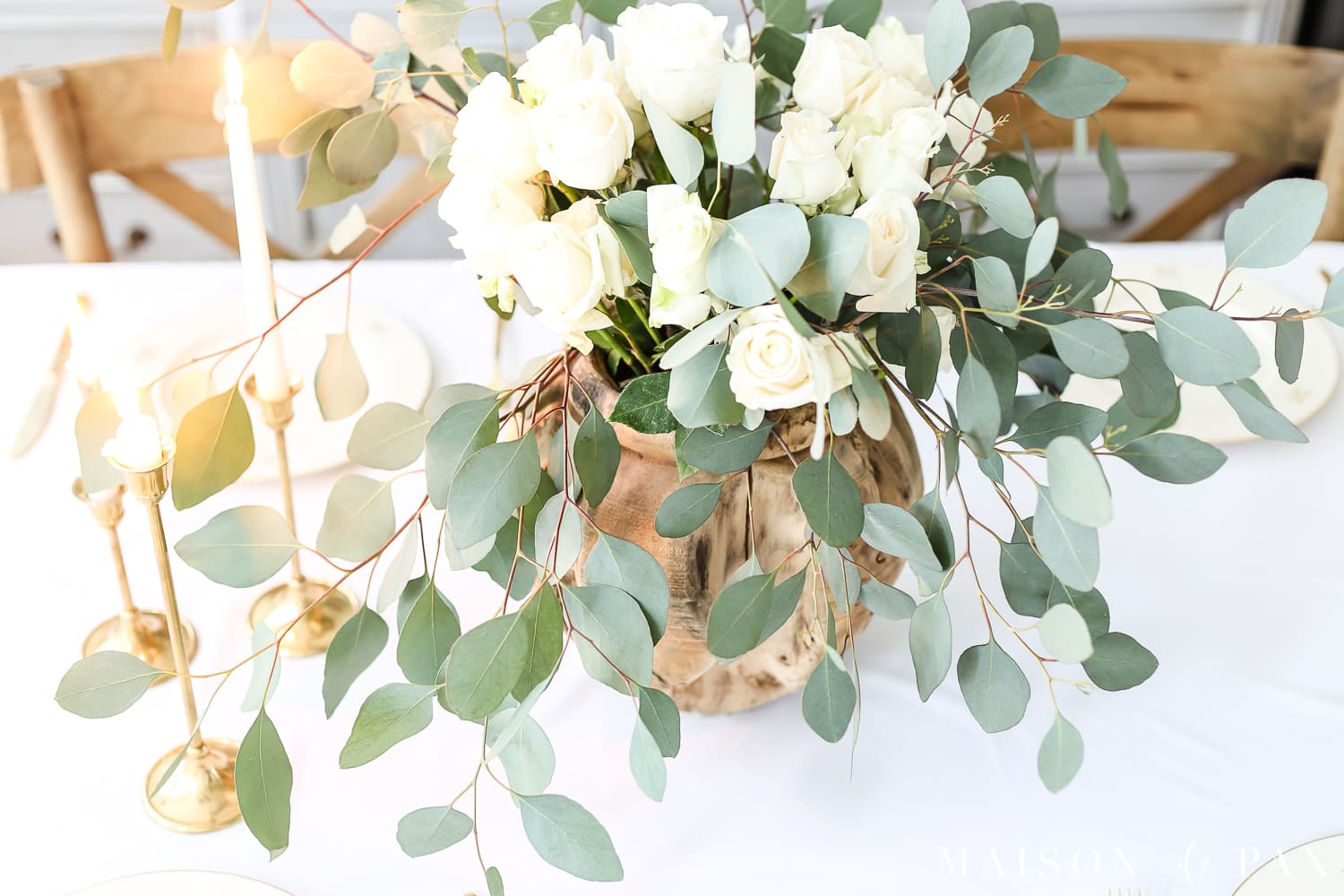 Romantic centerpiece: white roses and eucalyptus centerpiece- Maison de Pax