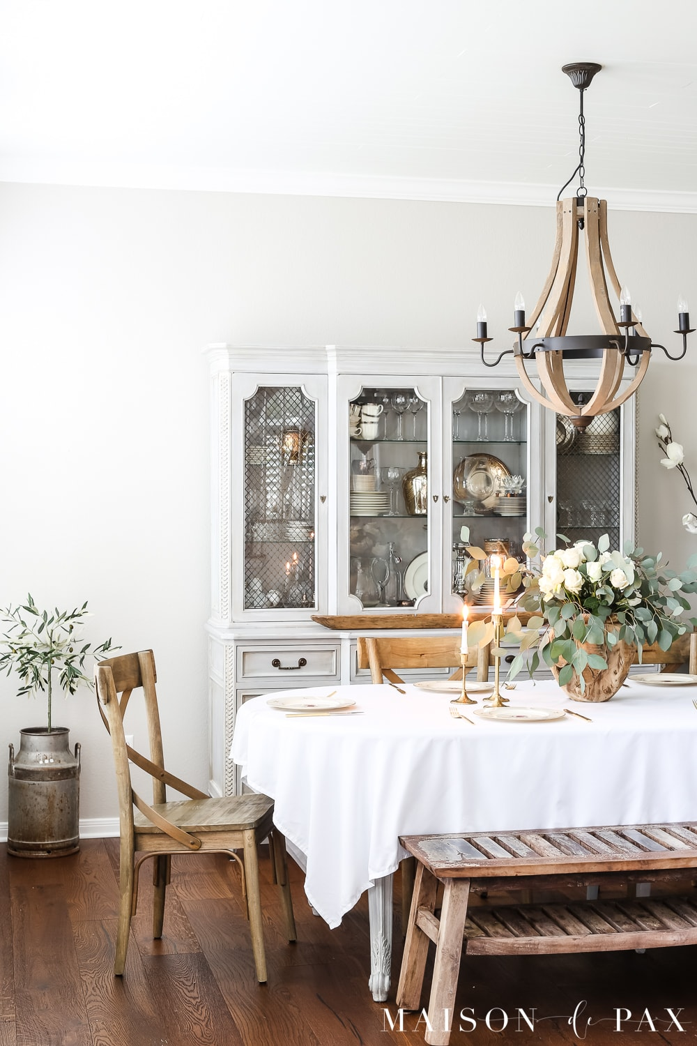 gorgeous french country dining room with a romantic rose and eucalyptus centerpiece - learn how to create this simple centerpiece #roseeucalyptus #tablescape #centerpiece #romantictable #frenchcountrydecor