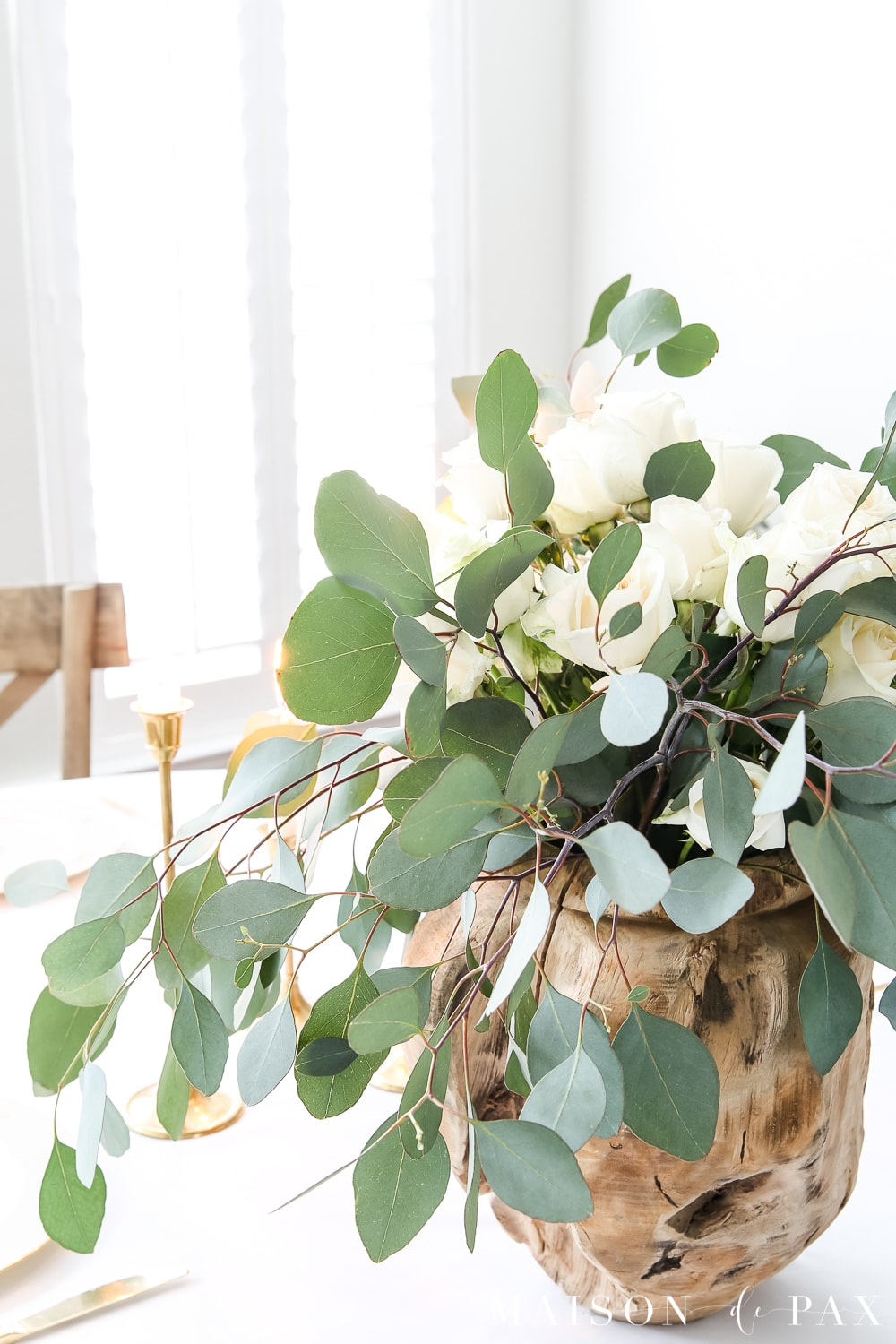 raw wood vase and white roses and eucalyptus centerpiece- Maison de Pax