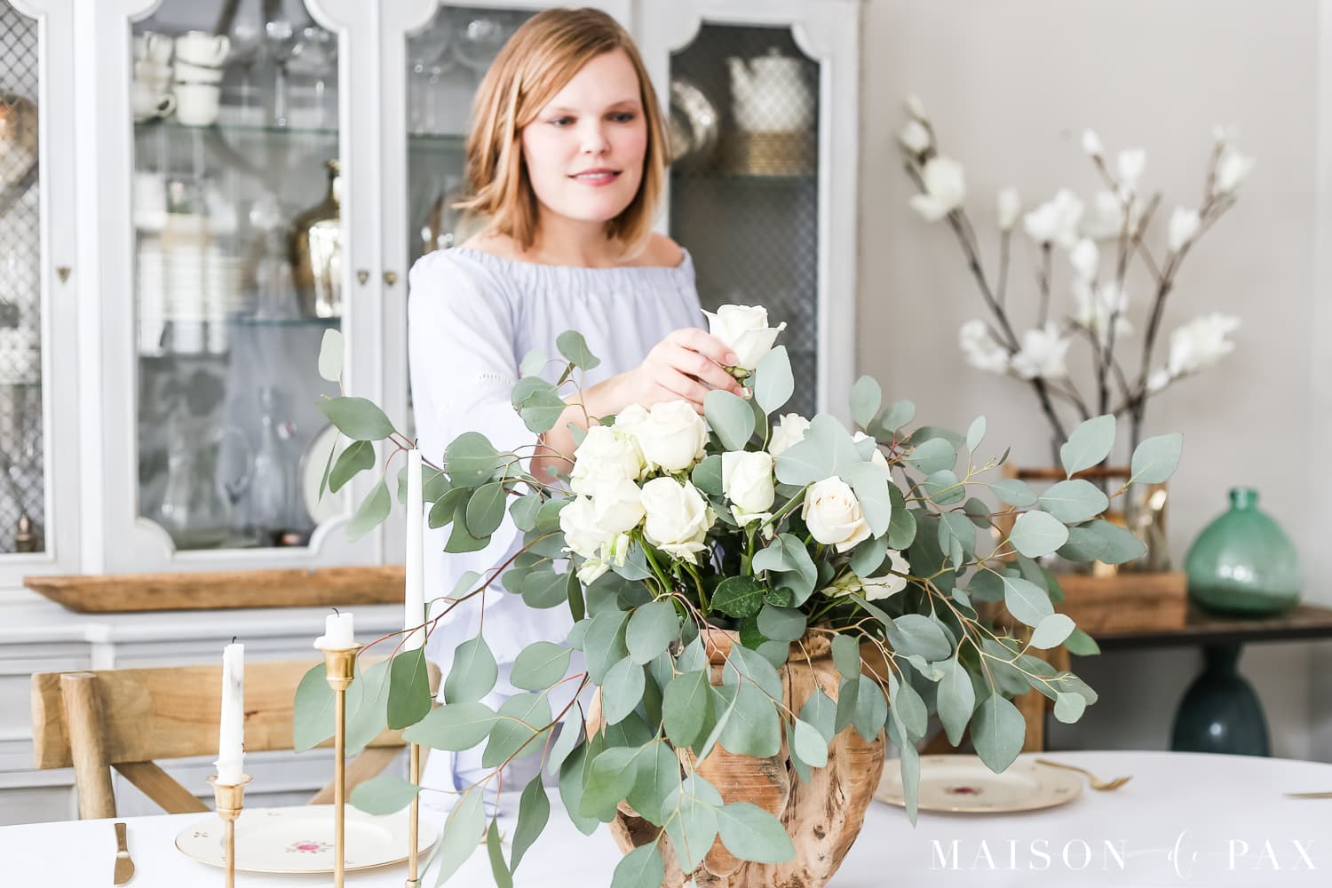 DIY centerpiece with white roses and eucalyptus