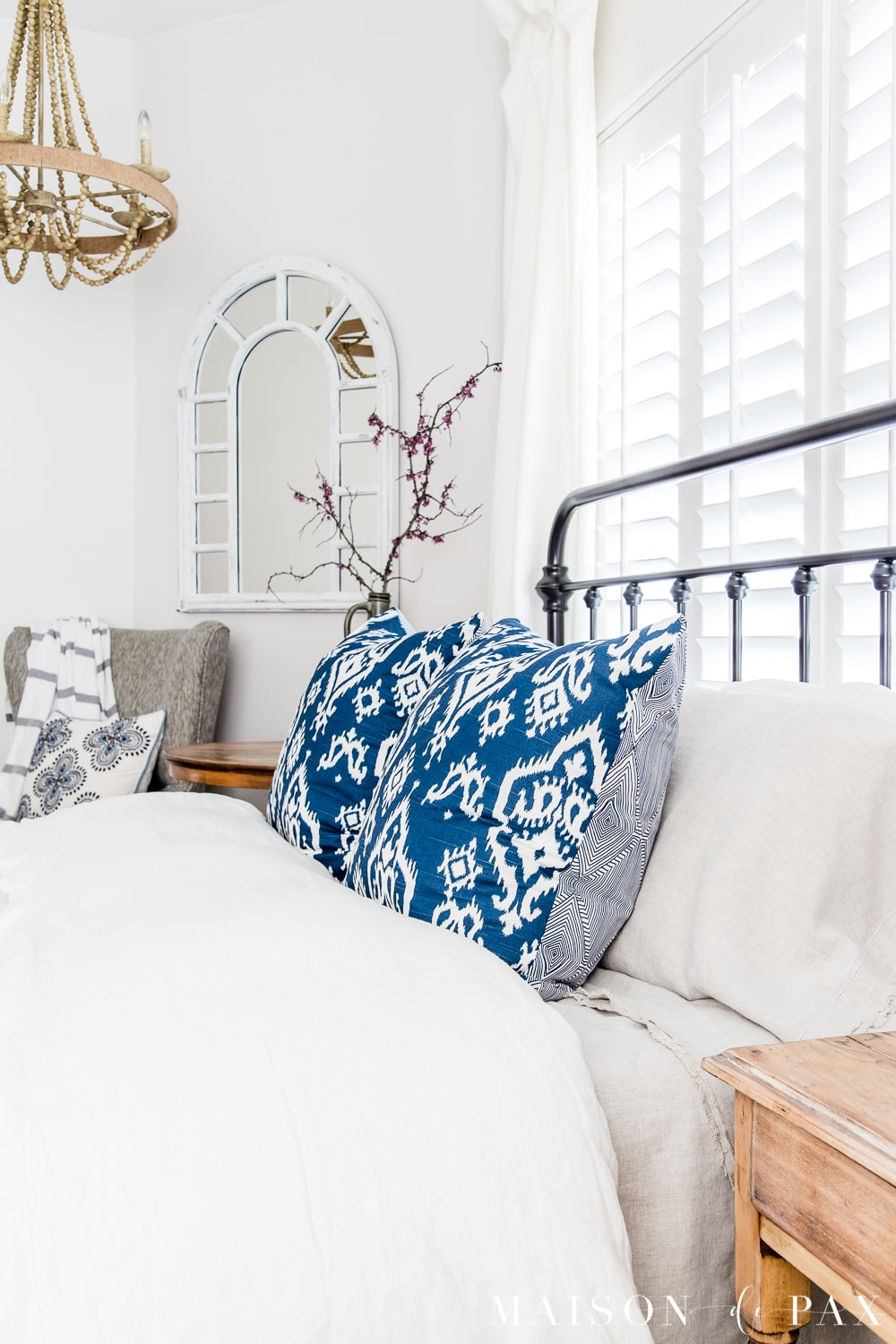 tip #3: accent with colorful pillows... Looking to add a seasonal touch to your bedroom?  Don't miss these incredibly simple master bedroom decorating ideas for spring! #springdecor #springbedroom #nightstand #modernfarmhouse