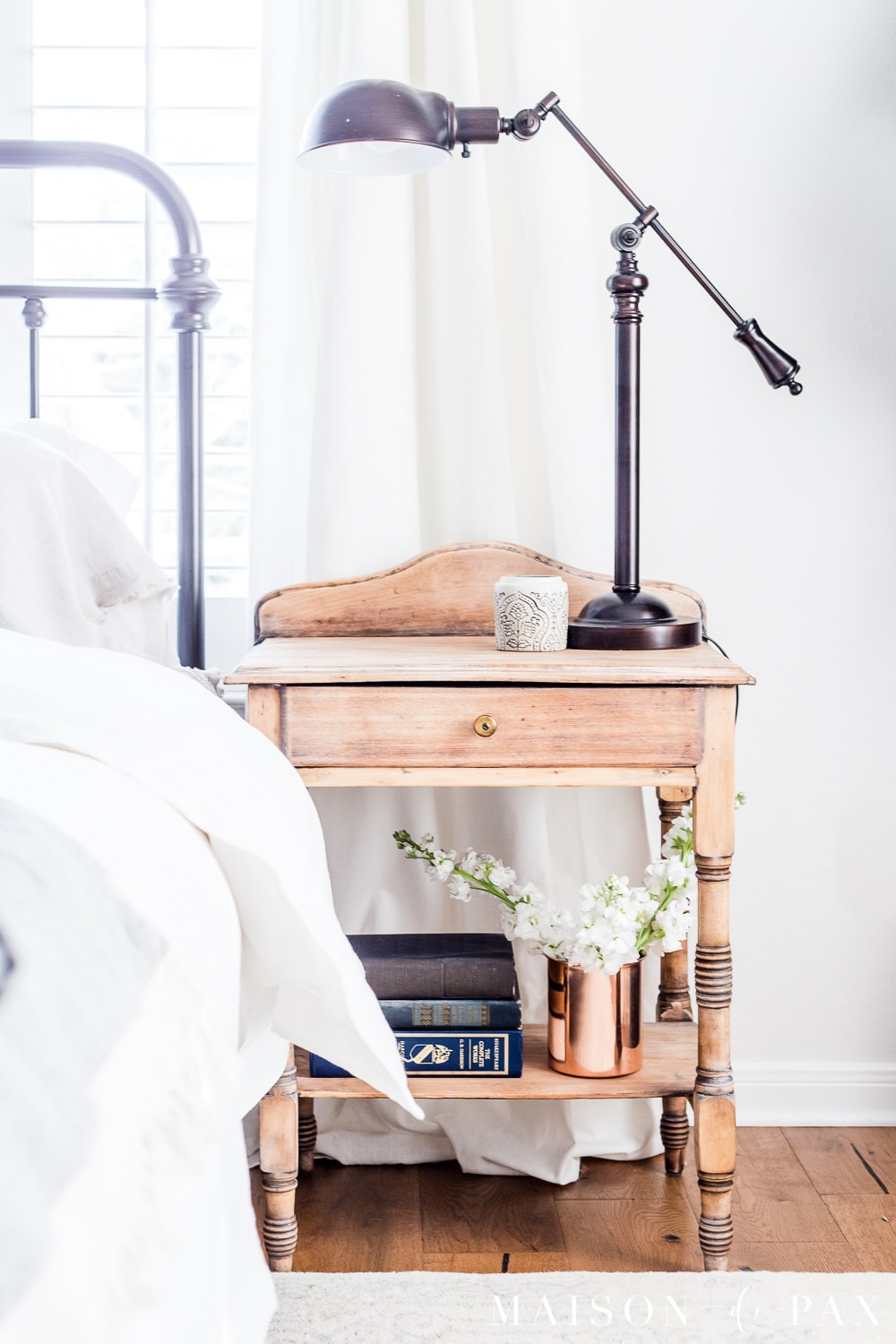 tip #5: add cut flowers in unexpected places... Looking to add a seasonal touch to your bedroom?  Don't miss these incredibly simple master bedroom decorating ideas for spring! #springdecor #springbedroom #nightstand #modernfarmhouse