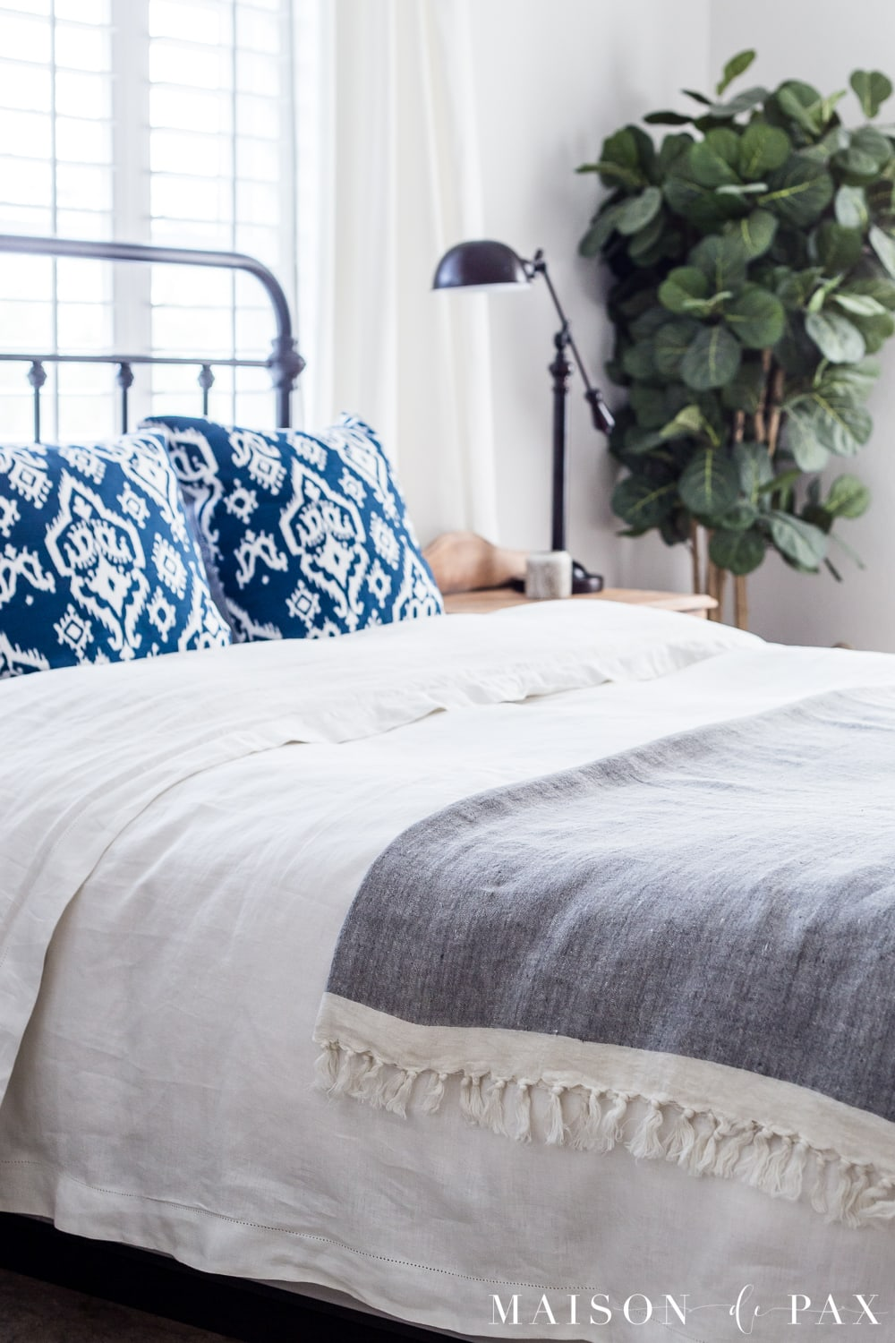 tip #2: use a linen throw... Looking to add a seasonal touch to your bedroom?  Don't miss these incredibly simple master bedroom decorating ideas for spring! #springdecor #springbedroom #nightstand #modernfarmhouse