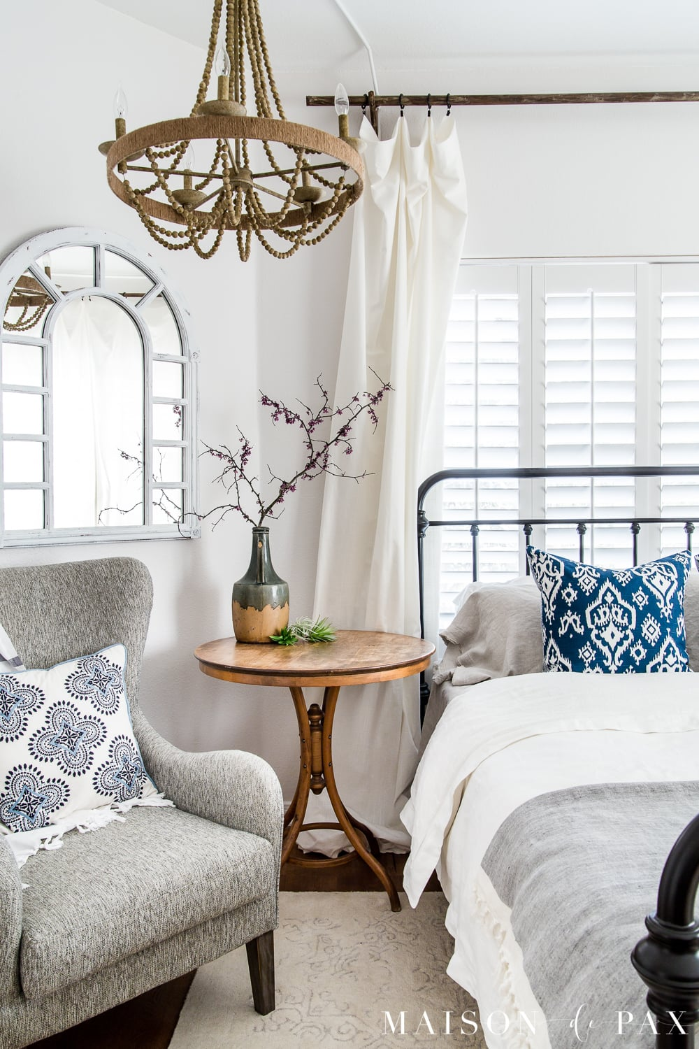 tip #4: create a floral focal point... Looking to add a seasonal touch to your bedroom?  Don't miss these incredibly simple master bedroom decorating ideas for spring! #springdecor #springbedroom #nightstand #modernfarmhouse