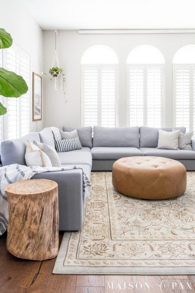 Wondering how to decorate a living room with a sectional? Get 5 tips to create a beautiful, open space! #sectionalsofa #modularsofa #livingroomdecor #livingroomdesign #rusticmodern #lightgraysectional #graysectional #neutrallivingroom