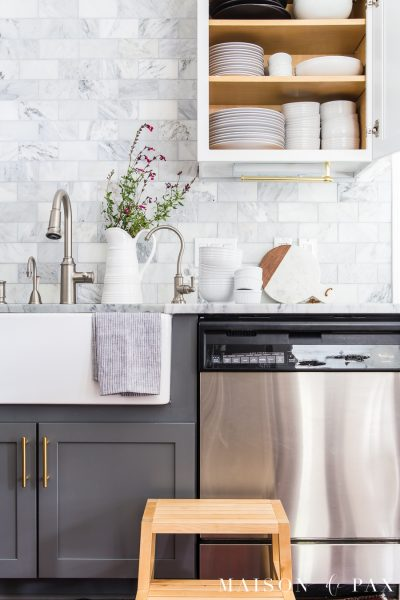 kitchen cabinet with organized white dishes