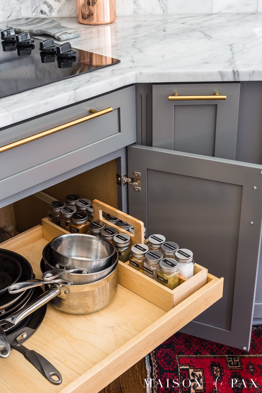 cabinet pull out with pots and pans and spice organizer- Maison de Pax