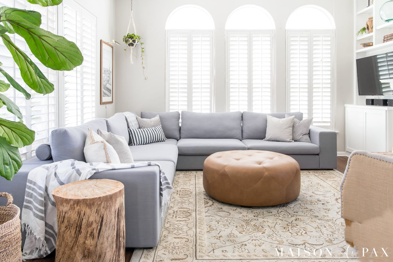 This Light Bright Living Room Is Ancd By A Large Blue Gray Sectional And Accented With