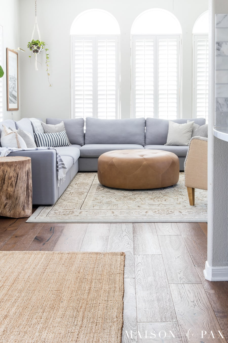 5 tips for decorating a living room with a sectional: learn how to create a gorgeous, layered, neutral look. #sectionalsofa #modularsofa #livingroomdecor #livingroomdesign #rusticmodern #lightgraysectional #graysectional #neutrallivingroom