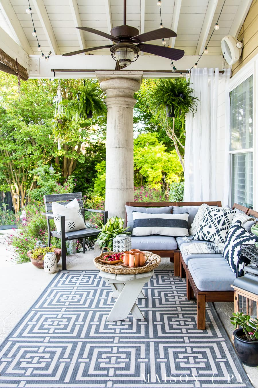 Beautiful summer patio with hanging ferns and blue and white patio furniture- Maison de Pax