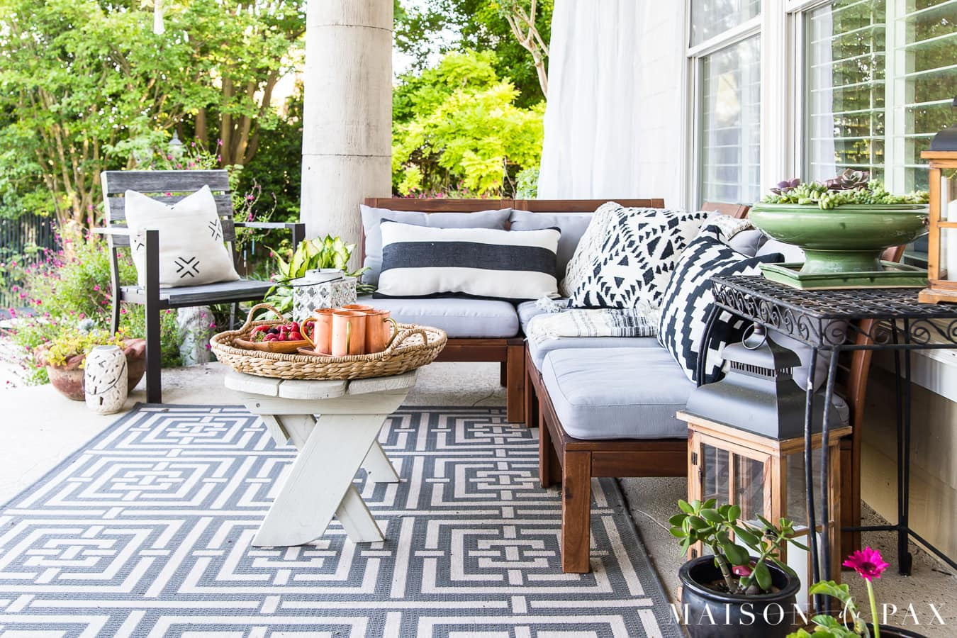 black and white porch with gray sectional- Maison de Pax