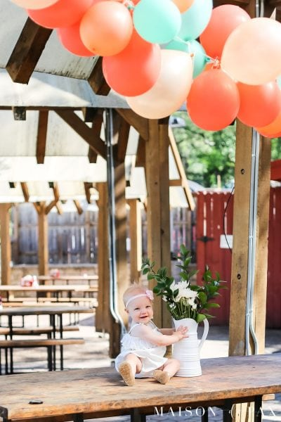 Balloon Garland Outdoor Decoration: This tutorial teaches you how to make a balloon garland for your next celebration! #balloongarland #celebrate #partydecorations #balloons #howto #babyshower #firstbirthday #weddingshower #partybackdrop
