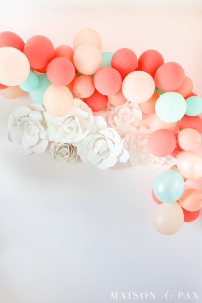 Balloon Garland Photo Backdrop: This tutorial teaches you how to make a balloon garland for your next celebration! #balloongarland #celebrate #partydecorations #balloons #howto #babyshower #firstbirthday #weddingshower #partybackdrop