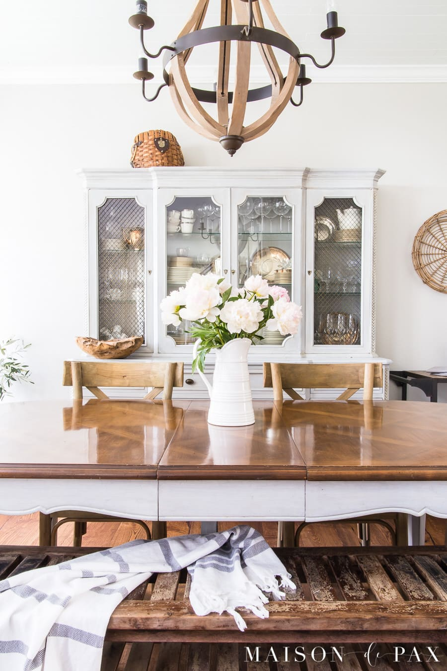 A French Country Dining Room Embodies A Rustic Elegance With Neutrals, Wood  Tones, And A Peony Centerpiece.
