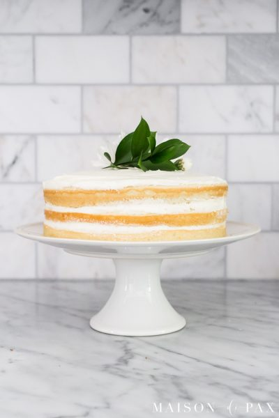 Learn how to make a naked cake! Tips and tricks for making, frosting, and decorating naked cakes the EASY way. #nakedcake #nakedcakerecipe #cakefrosting #howtofrost #cakerecipe #creamcheesefrosting #cakedecorating #whitecake