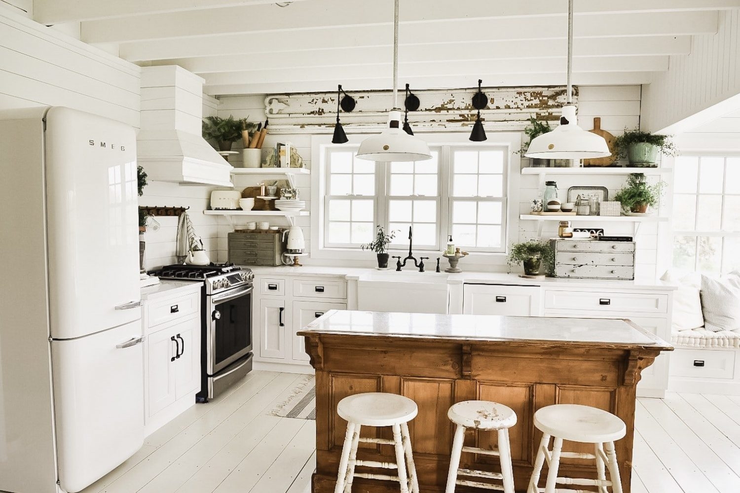 Liz Marie Blog kitchen: rustic antique wood island amidst white cabinetry- Maison de Pax