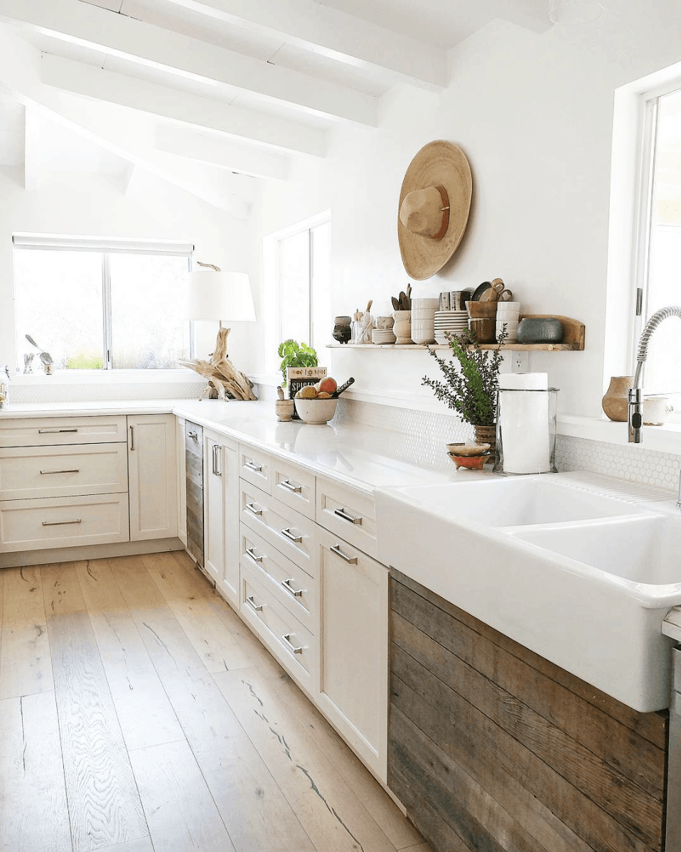 The Ranch Uncommon kitchen: wide plank white oak floors, rustic wood and white cabinetry, open shelving, farmhouse sink- Maison de Pax