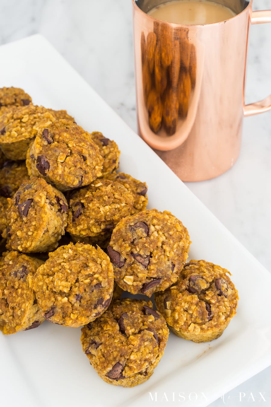 Gluten free pumpkin mini muffins: Made with applesauce and a touch of maple syrup for sweetening, oat flour, and pumpkin, these are packed with delicious flavor and nutritious ingredients #gf #glutenfree #pumpkinspice #fallrecipe #pumpkinrecipe #pumpkinmuffins #breakfast #gfbreakfast