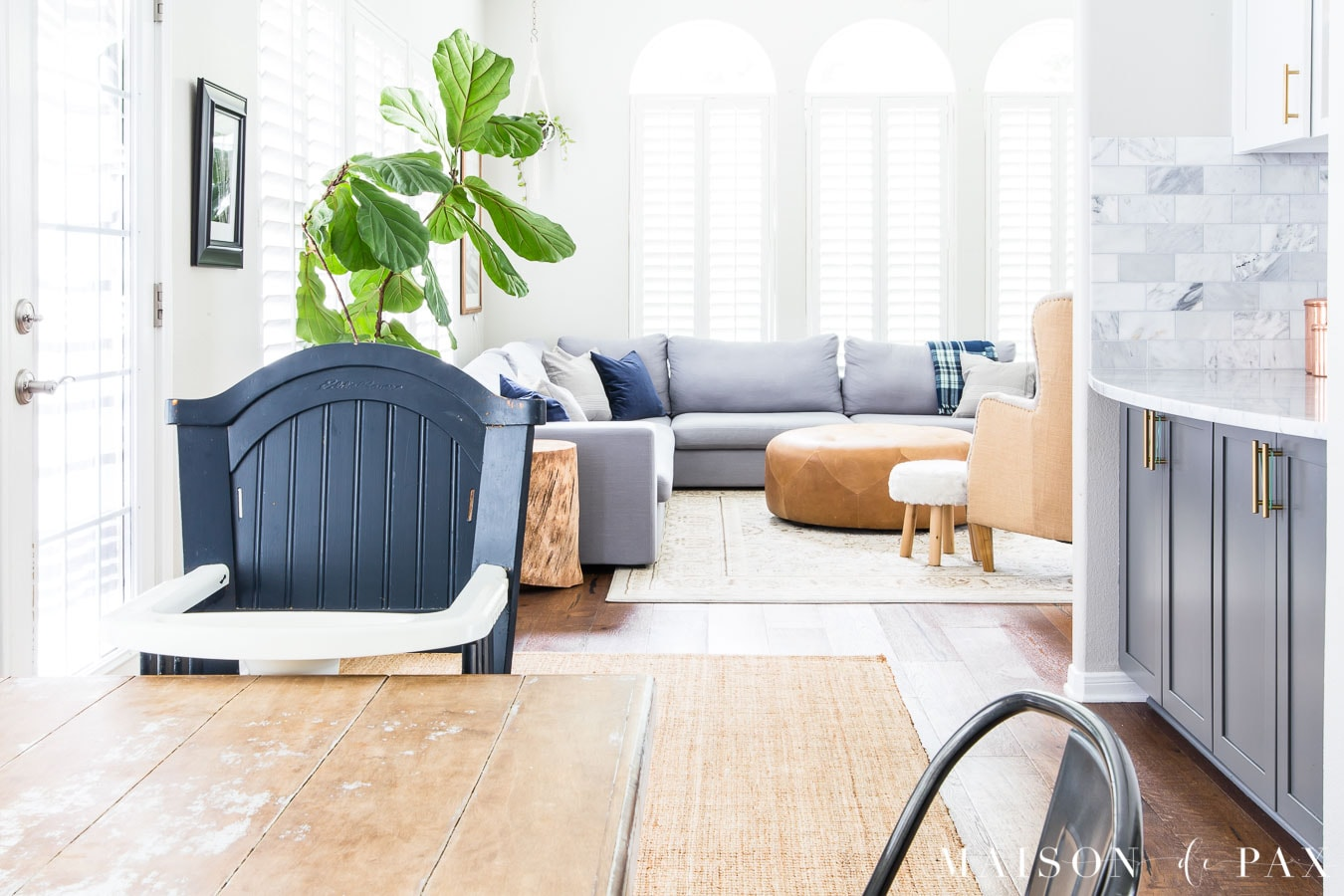 kitchen table and family room area with brown wood floors | Maison de Pax