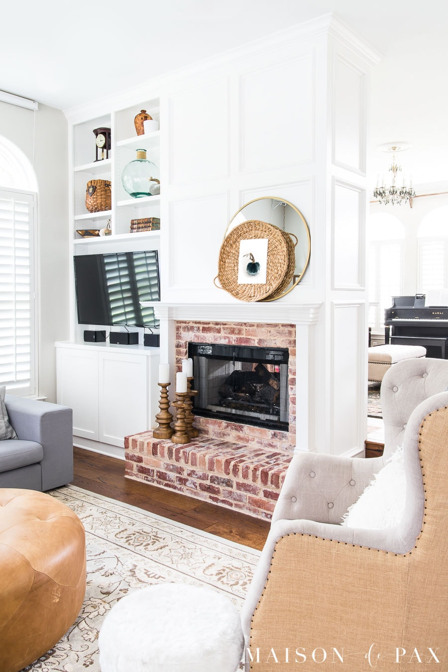 White fireplace molding and antique brick fireplace- Maison de Pax
