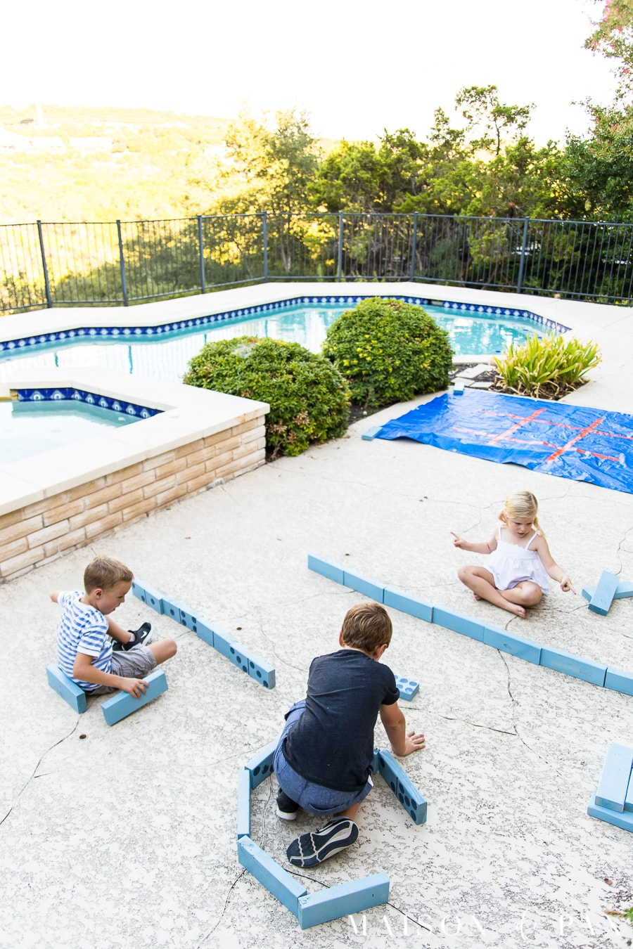 Make giant dominoes and tic tac toe with your kids: find this and other family projects plus tips for completing project with kids! #familyfun #familyproject #outdoorgames #kidfriendlyproject #diyproject