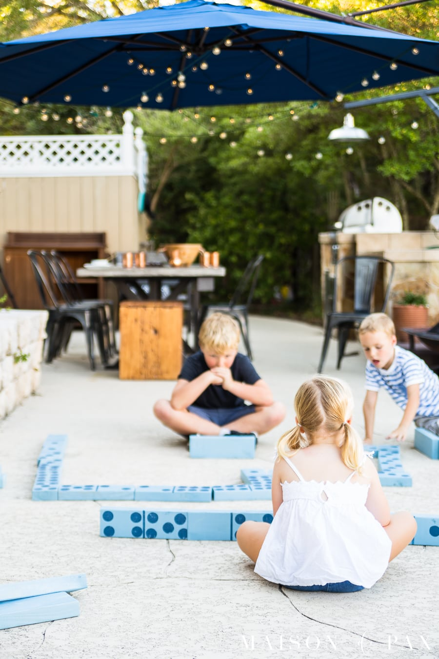 Make giant dominoes and other yard games with your kids: find this and other family projects plus tips for completing project with kids! #familyfun #familyproject #outdoorgames #kidfriendlyproject #diyproject