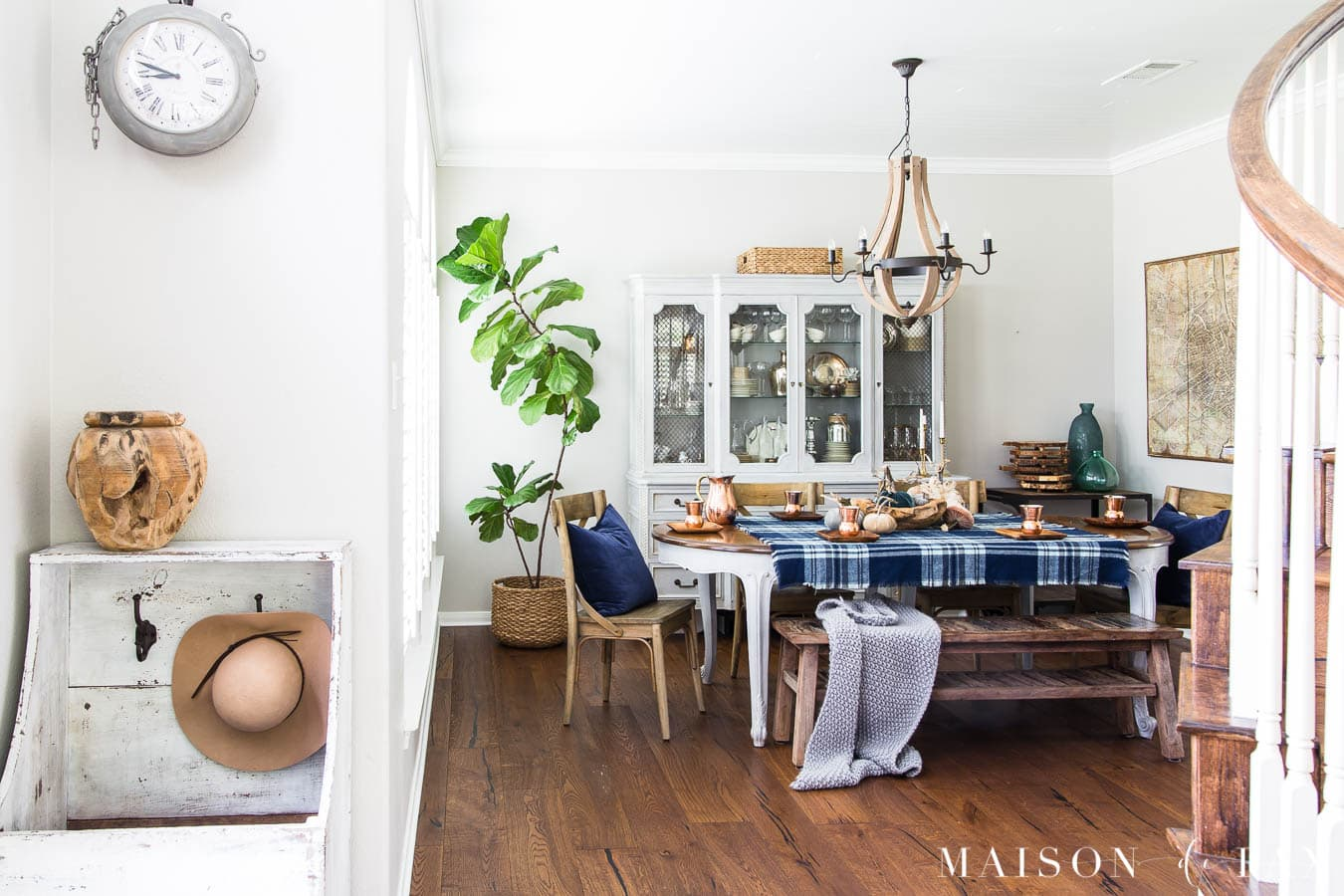 gray fall dining room with blue velvet and plaid tablescape