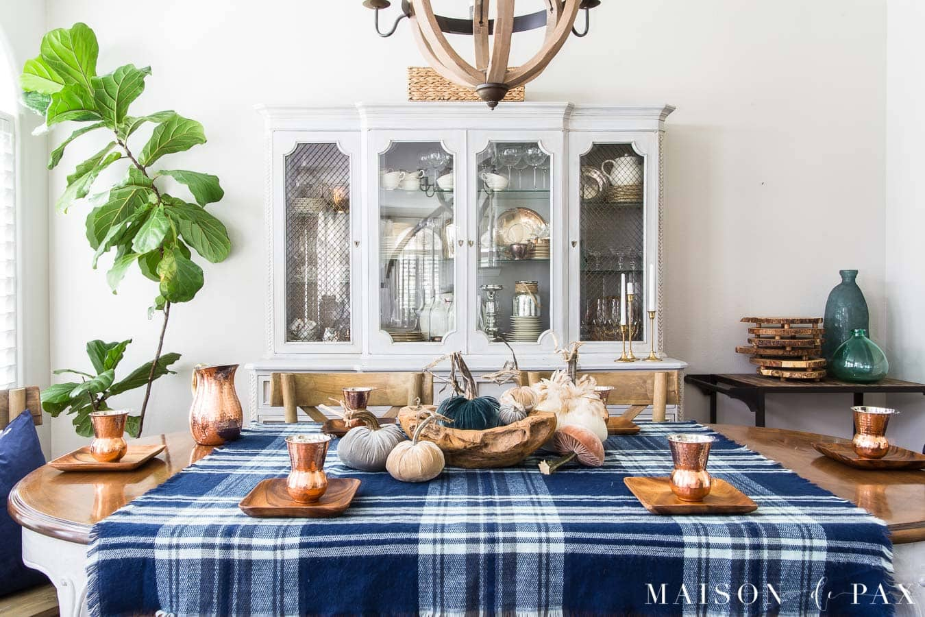 fall table with velvet pumpkins and blue plaid tablecloth
