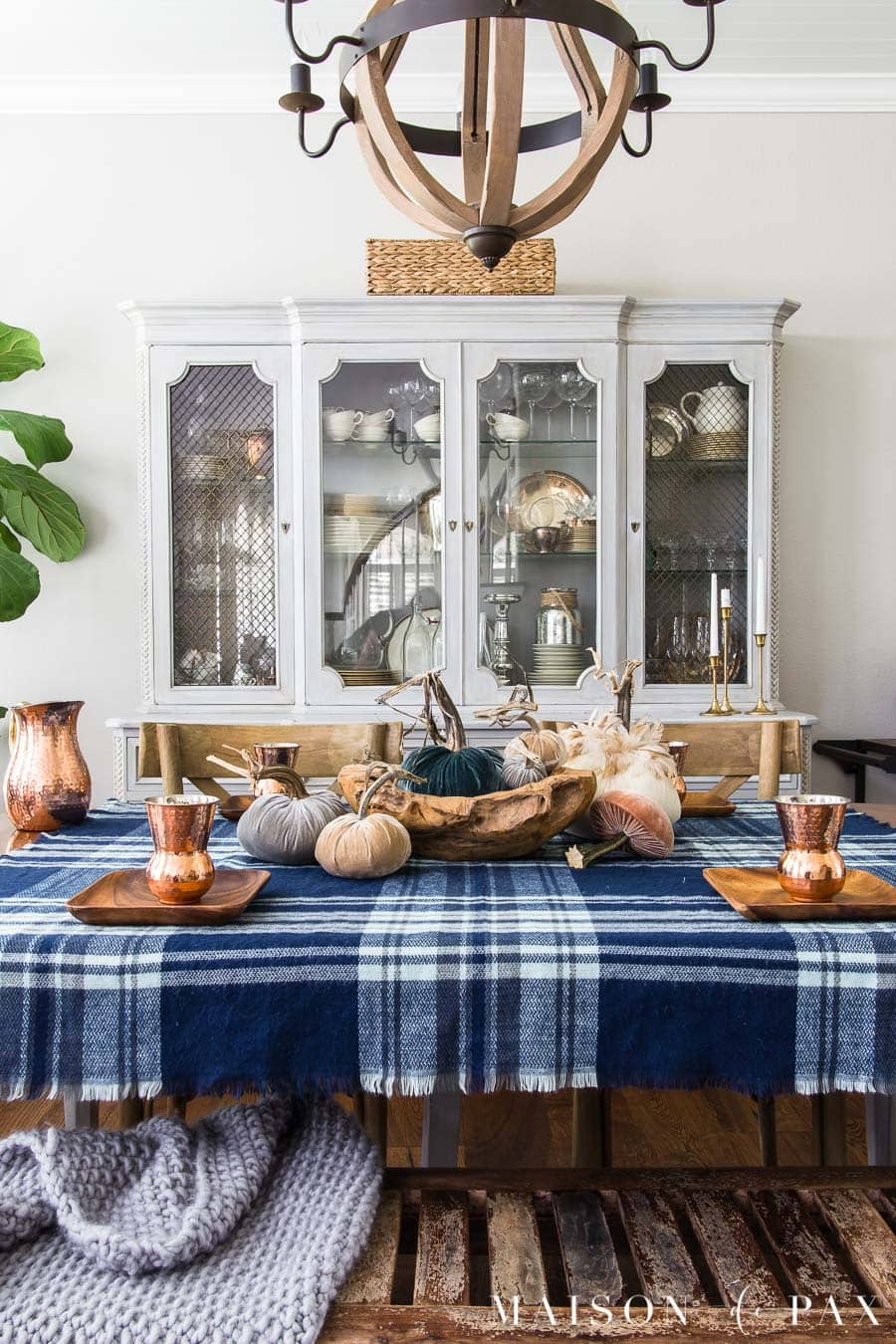 Get ideas for non-traditional fall decorating with this blue velvet pumpkin centerpiece! #velvetpumpkins #falltable #bluefalldecor #falldecorating #falldecor #tablescape #plaid #pumpkincenterpiece