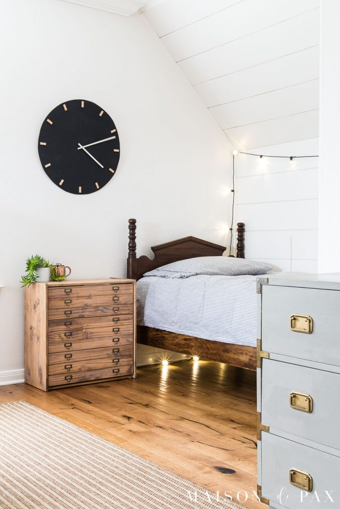 simple white room with plank wall and antique twin bed giving a modern look to a home build in the 90s | Maison de Pax
