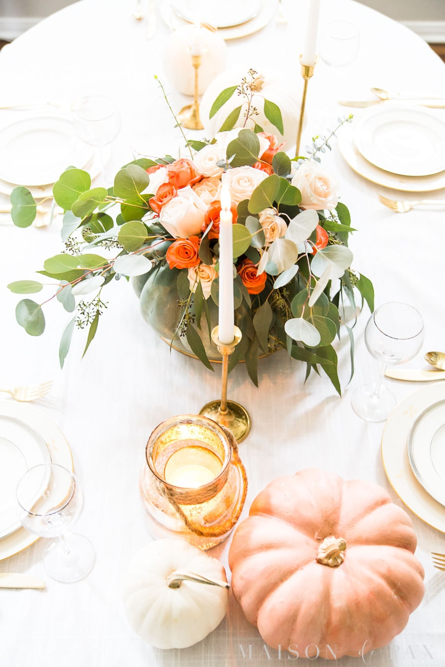 pumpkin centerpiece with gold and ivory china