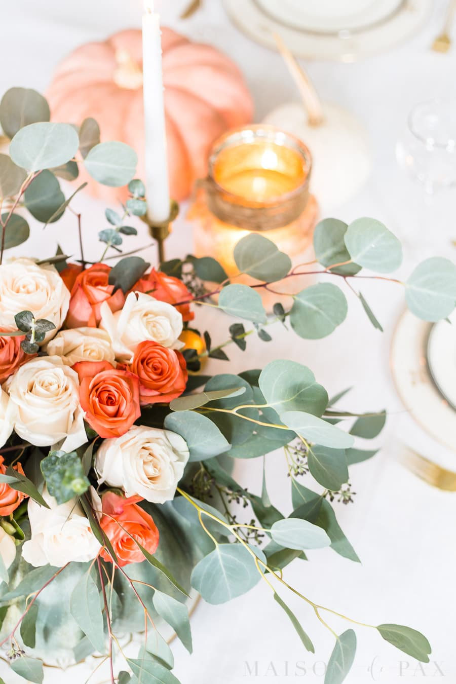 roses and eucalyptus centerpiece