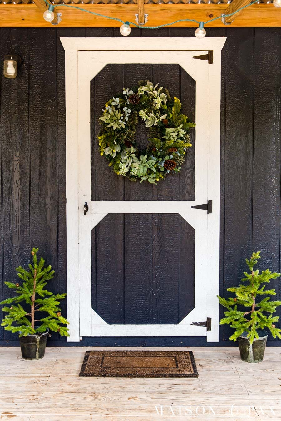 black barn door with white trim