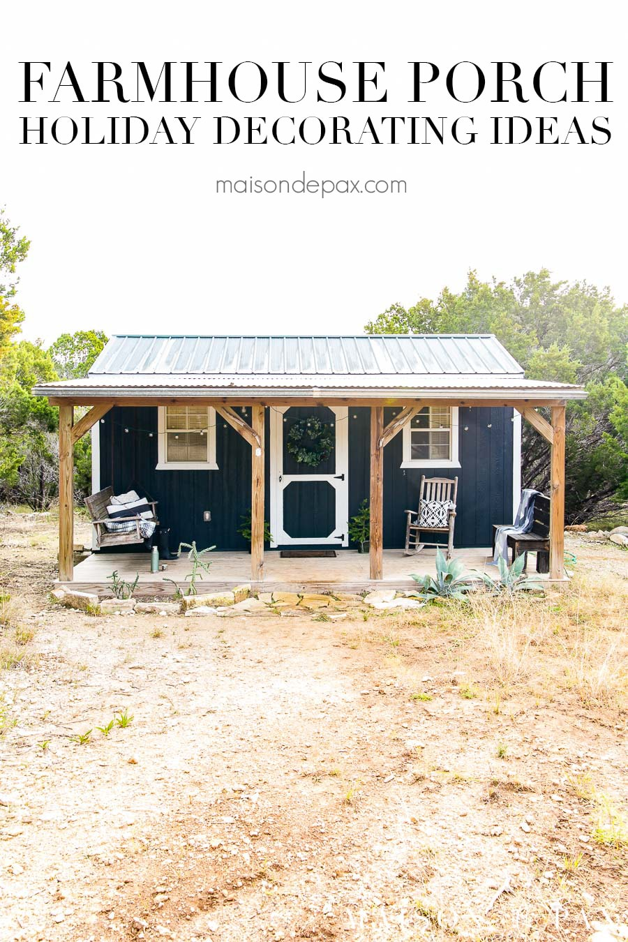 black and white tiny house out in the country with a charming porch