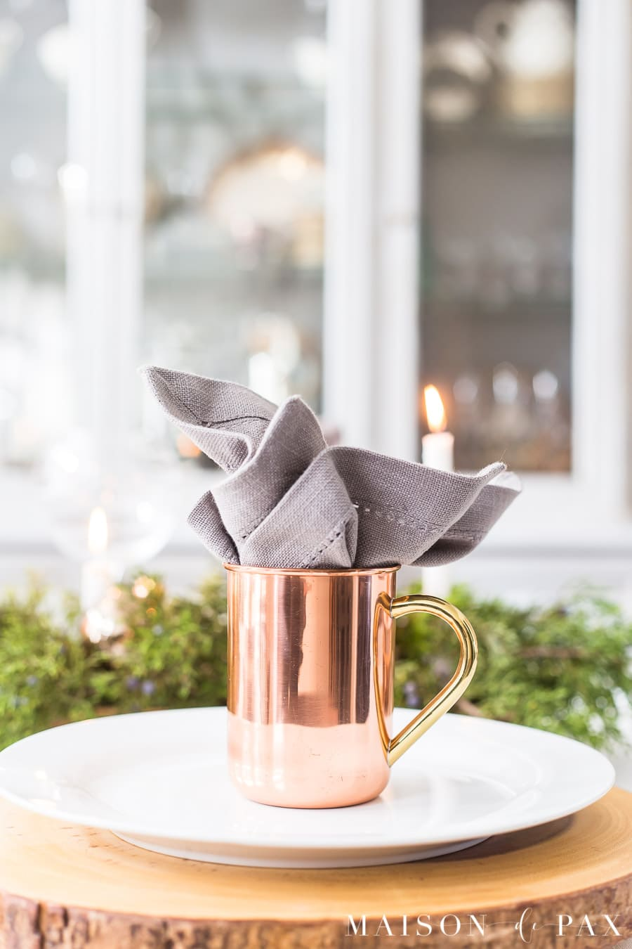copper moscow mule mug stuffed with gray napkin