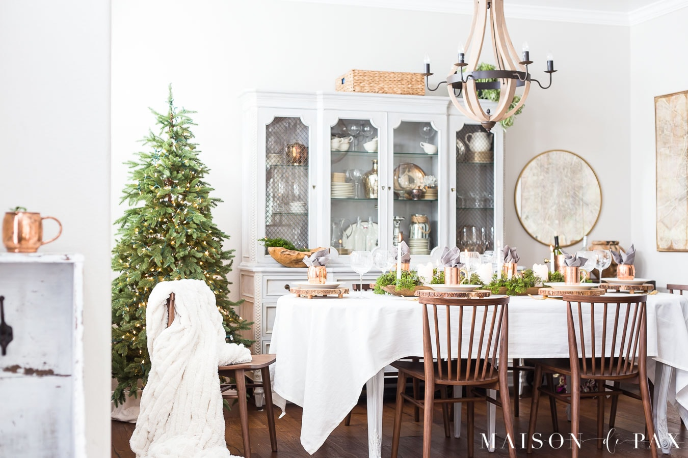 french country dining room with white, green, and copper holiday accents