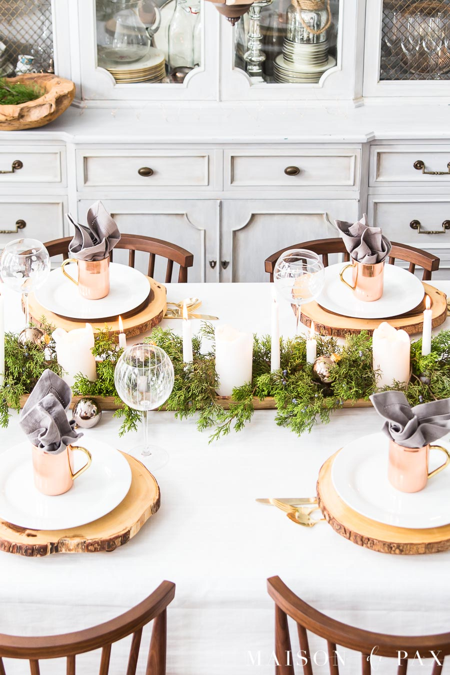 white tablecloth on a dining table with modern farmhouse style decorations