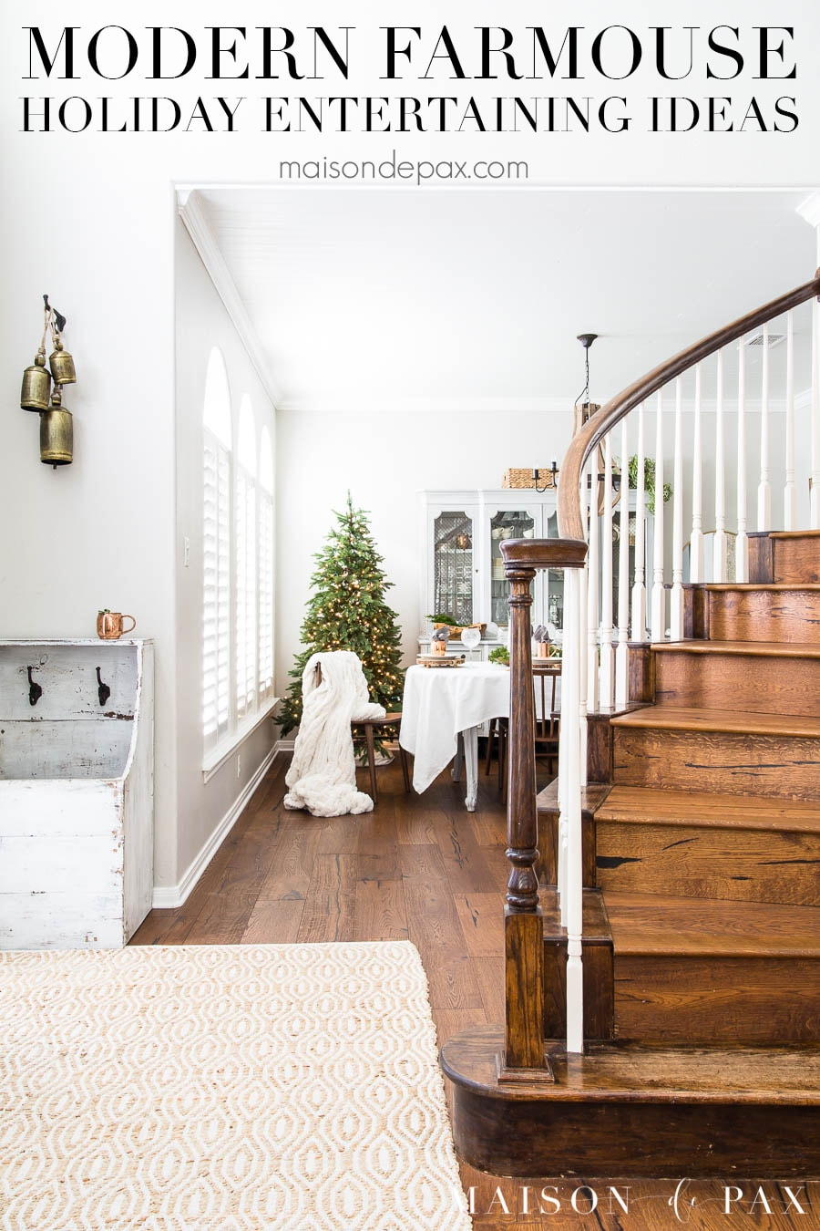 """view of wooden staircase and dining room beyond with Christmas tree and text overlay that reads """"modern farmhouse holiday entertaining ideas"""""""