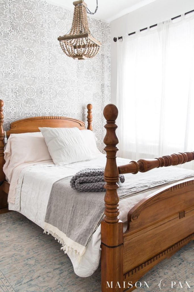 antique bed with white and gray bedding stencil accent wall | maison de pax
