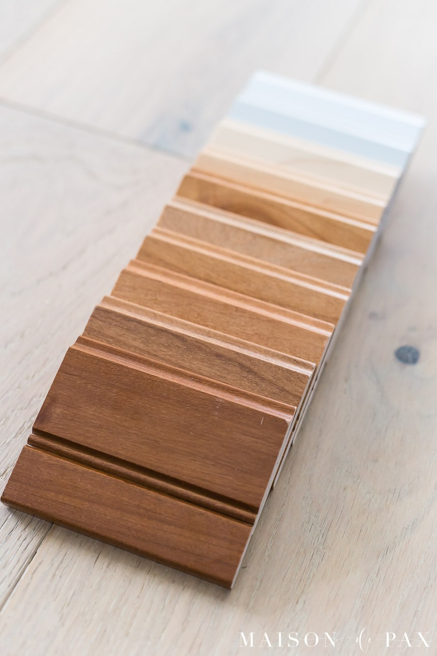 10 different cabinet finish samples ranging from medium wood to white