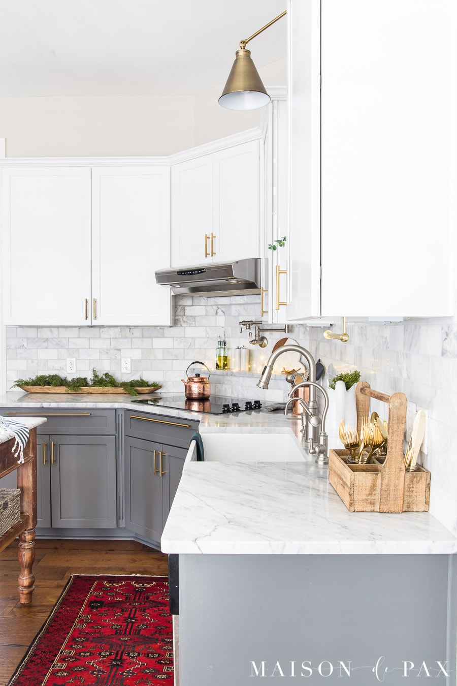 marble countertops and two tone cabinets with Agreeable Gray walls | Maison de Pax
