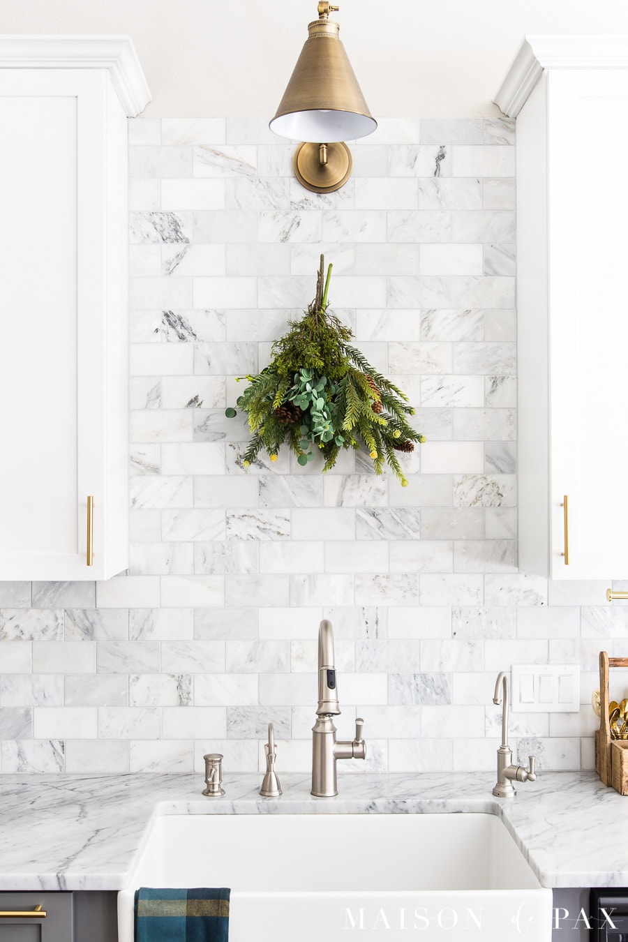 simple swag with real and faux greenery hanging in a kitchen