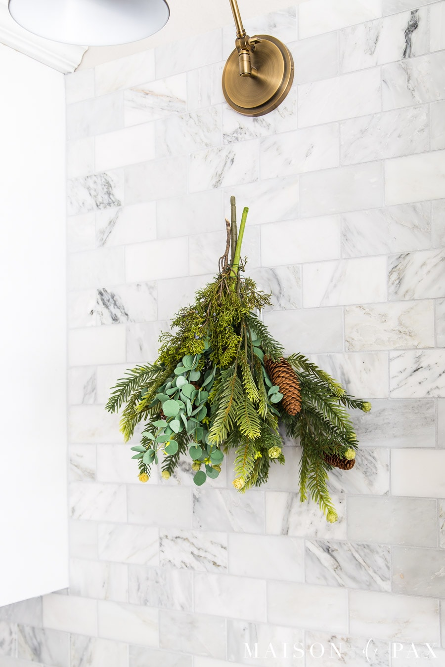 super easy holiday swag hanging on marble kitchen backsplash- Maison de Pax